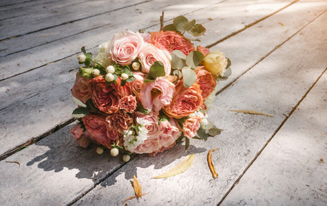 wedding bouquet on the wooden floor
