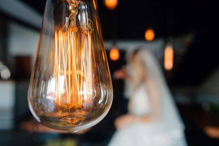 retro bulbs lights  newlyweds couple embracing