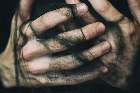 Hands and black spiderweb
