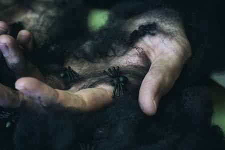 Hands and black spiderweb