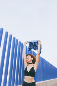 Redhead woman against blue wall