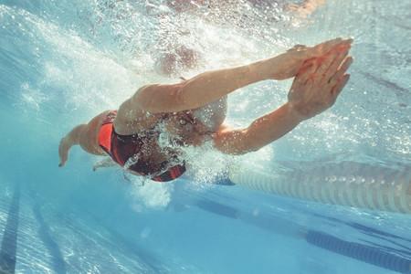 Professional swim athlete gliding in pool
