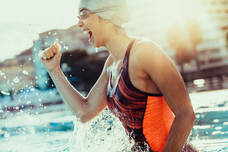 Excited female swimmer celebrating victory