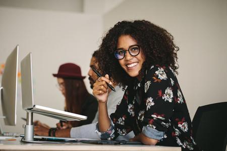 Smiling businesswoman holding a digital pen