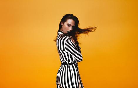 Glamorous female model in studio