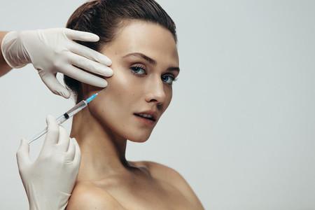 Beautiful woman having skin injections
