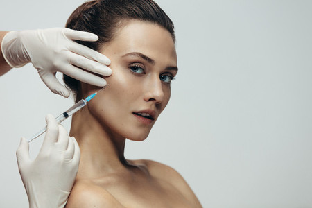 Beautiful woman having skin injections