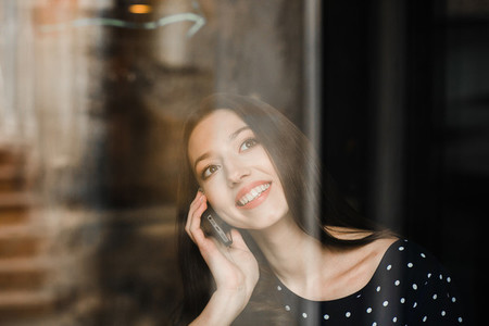 Beautiful girl talking on the phone and smiling
