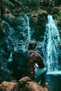 Hiker looking at waterfall