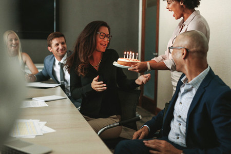 Surprise birthday celebration of a female during office meeting