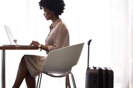 Female business traveler waiting for flight