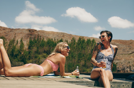 Women on vacation having fun at a lake