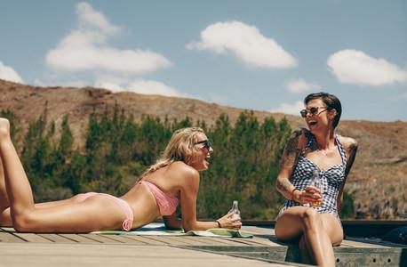 Women on vacation having fun at a lake