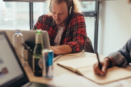 Programmer working on laptop at startup company