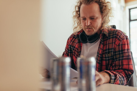 Man reading some documents in office
