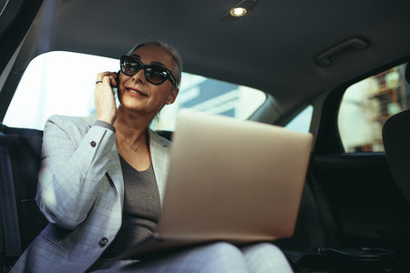 Female entrepreneur traveling to office in a luxury car