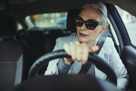 Senior woman driving a modern car