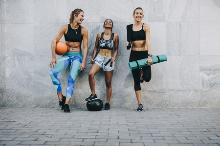 Women in fitness wear standing on street after workout