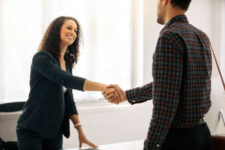 Businesswoman shaking hand with a business partner