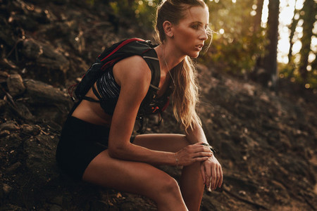 Female athlete relaxing after a trail run