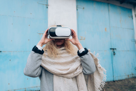 Girl in the street with a vr glasses