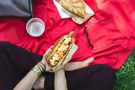 Eating hot dog while having picn
