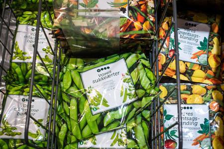 Frozen garden peas in freezer