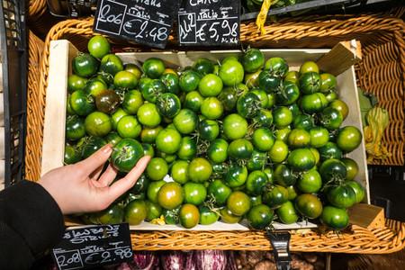 Italian green tomatoes in a groc