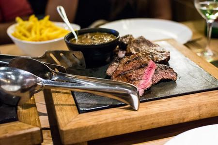 Juicy rare done steak in a steak