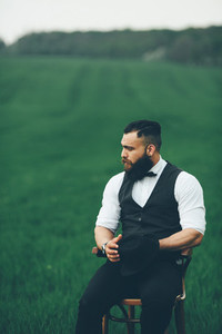 man with a beard  thinking in the field
