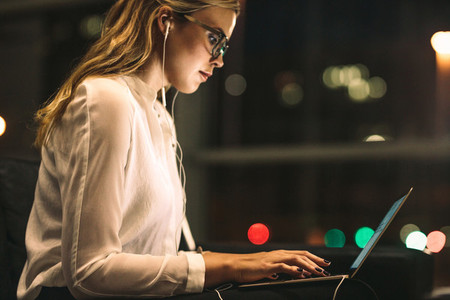 Young woman working late at office