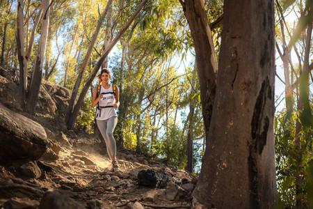 Fit trail runner in mountain trail marathon