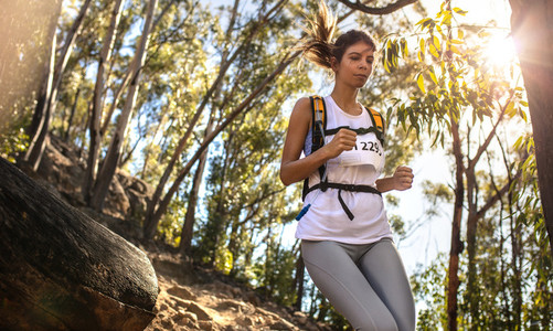Young woman running in a mountain race
