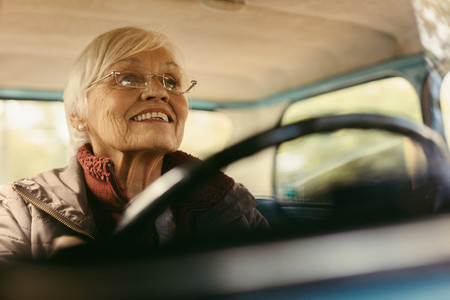Senior woman carefully driving a car