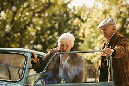 Senior gentleman opening the car door for his date
