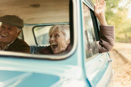 Senior couple enjoying on their road trip
