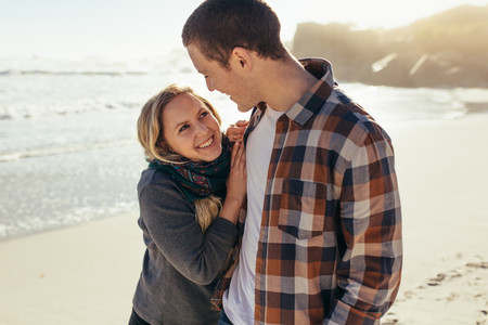Loving couple standing outdoors at the beach
