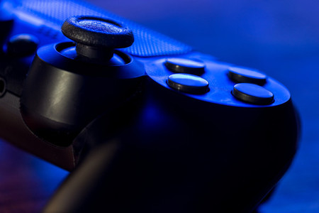 Video game controller night with lights closeup