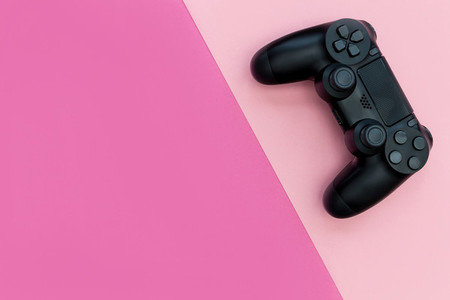Video game controller bright pink background