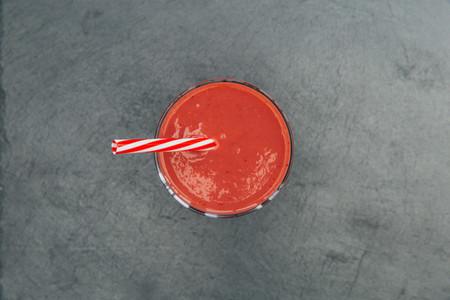 Red smoothie strawberry drink dark background