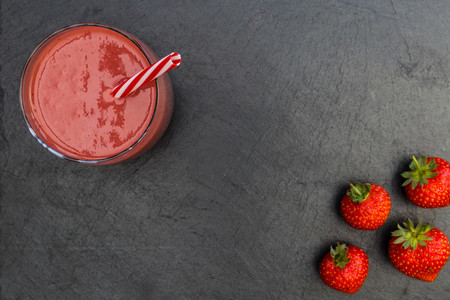 Red smoothie strawberries drink dark background