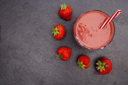 Red smoothie strawberries drink dark background