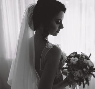Bride posing in a large window