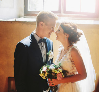 bride and groom on the background of a window