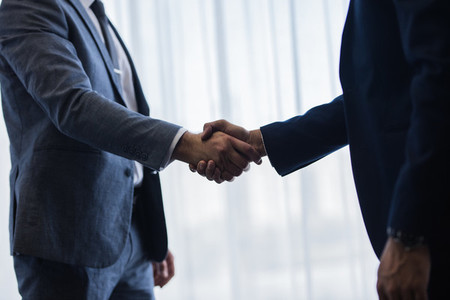 Businessmen handshaking after good deal