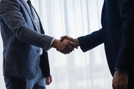 Businessmen handshaking after good deal