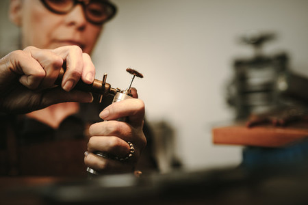 Jeweler preparing the tools for making jewelry