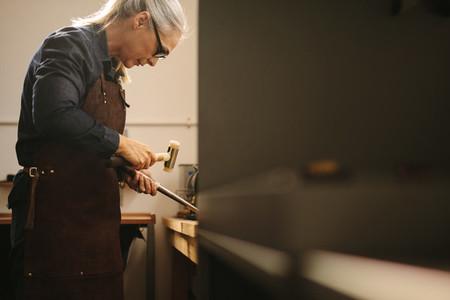 Senior woman making jewelry