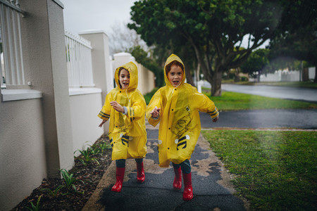 Girls in rainy weather on the road