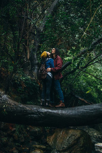 Couple in love getting wet in rain at forest